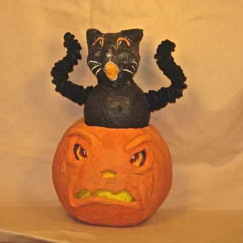 Gato de Halloween con calabaza