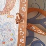 Libreta decorada con decoupage lazo asas